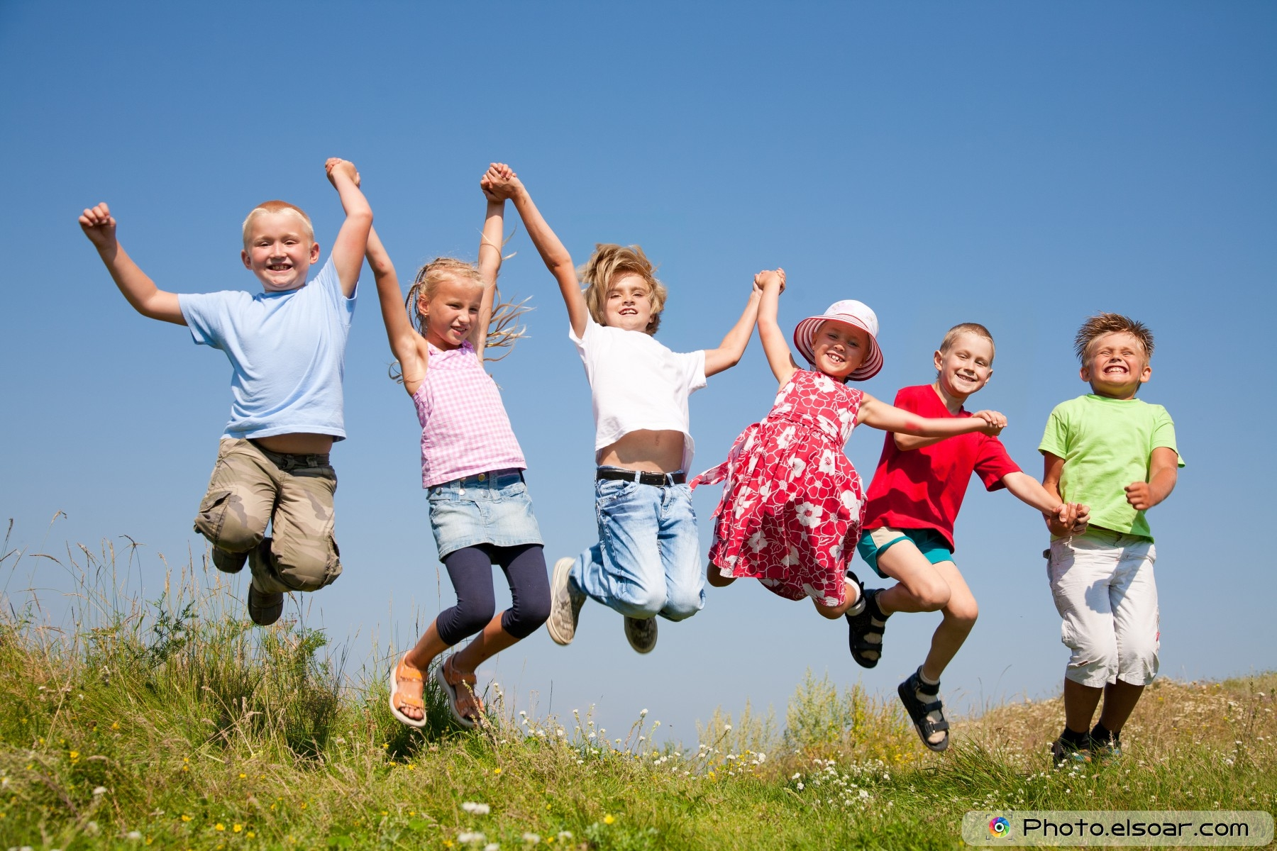 Group-happy-children-jumping-on-summer-meadow